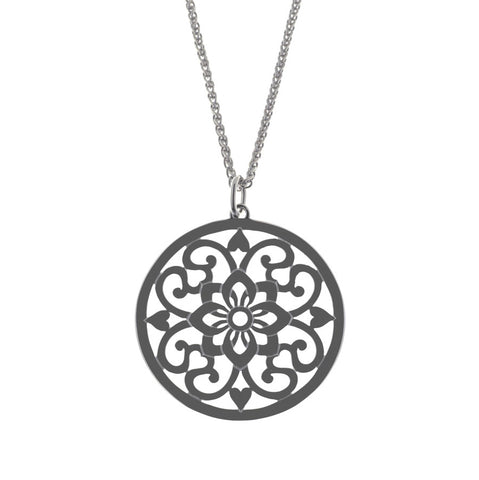 Moroccan inspired pendant design carved in sterling silver. It's round at  28mm in diameter.