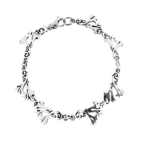 Seven links of stylised floral motifs form this distinctive and exclusive, rustic sterling silver bracelet, 19.5cm long, ref 7538L.
