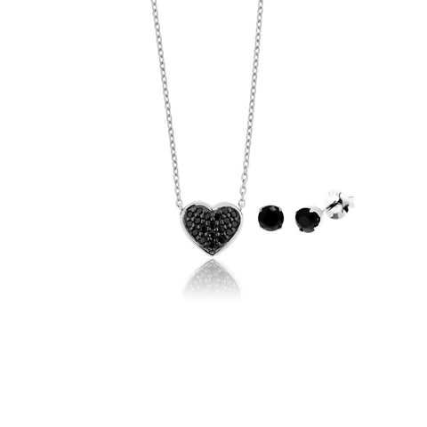Charlie heart set with silver necklace with a dainty heart-shaped pendant covered in black cubic zirconias, and round stud earrings with black cubic zirconia stone in claw setting.