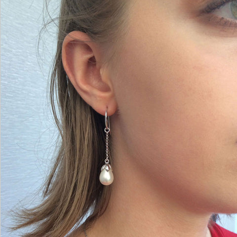 Sterling silver earring with white, pearl shell teardrops capped with sterling silver sepals, ref 7247.