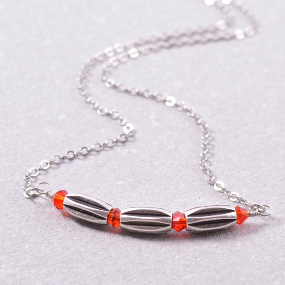 Silver Bar Necklace with Three Tubular Rice Beads and Red Swarovski Crystals