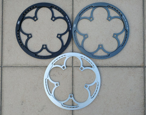 Single piece chainring with guard