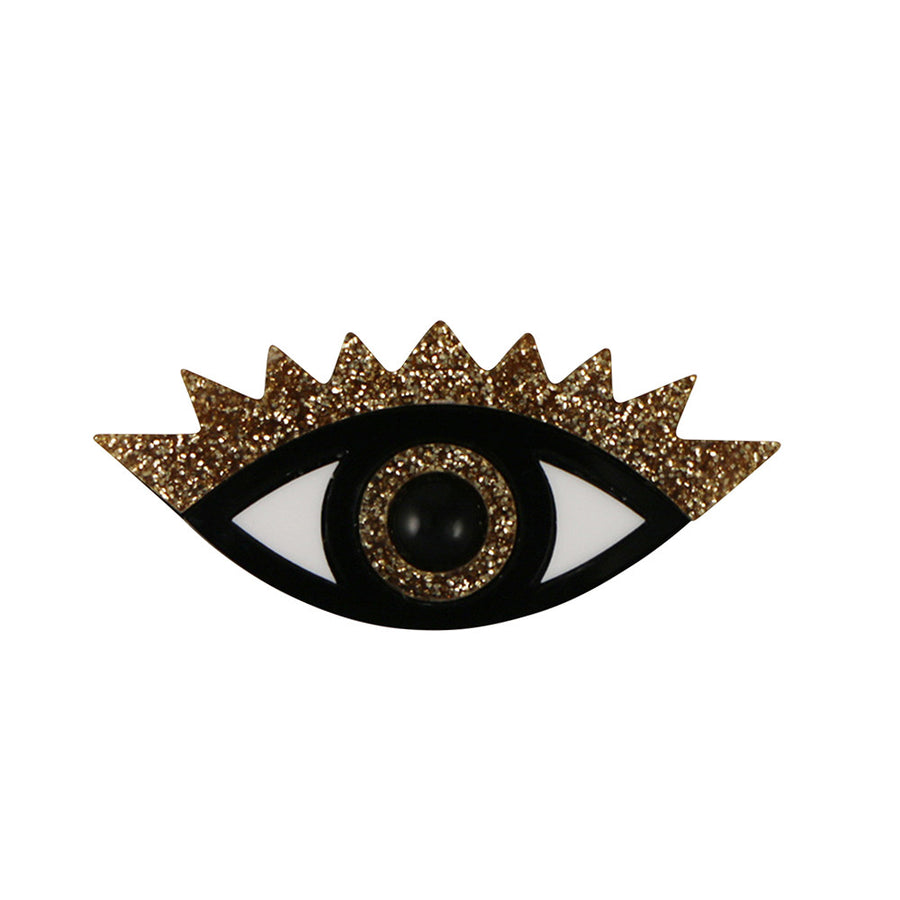 An Eye for an Eye Brooch in gold glitter