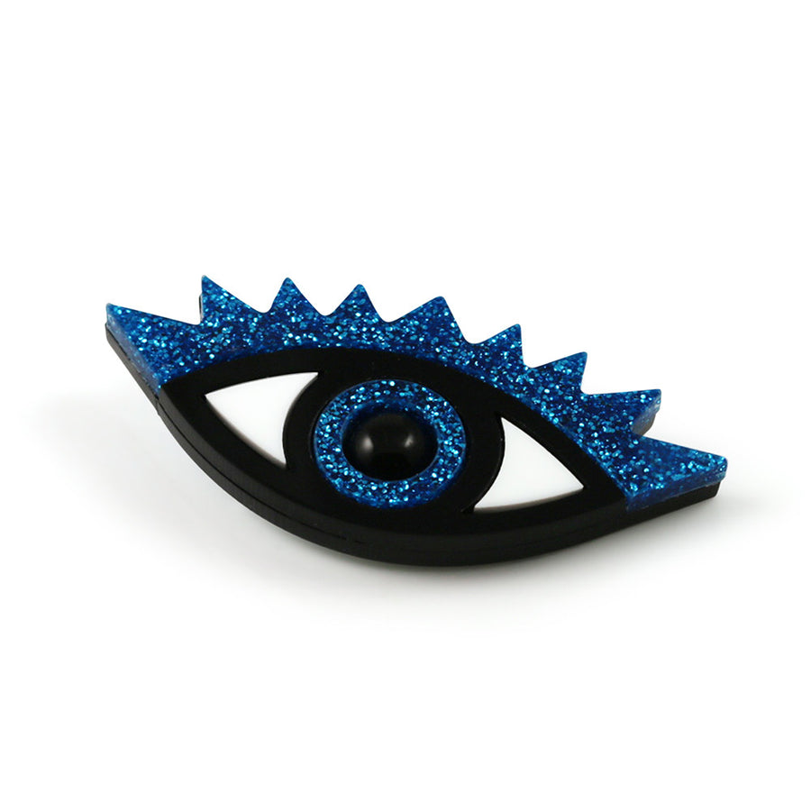 An Eye for an Eye Brooch in blue glitter