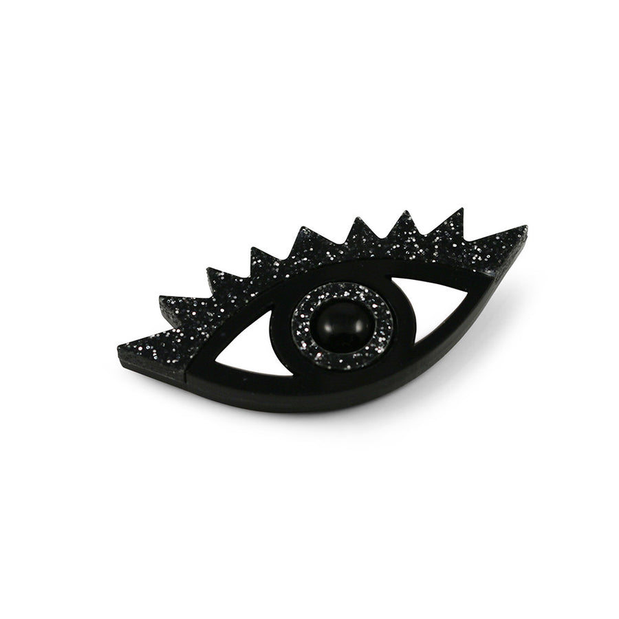 An Eye for an Eye Brooch in black glitter