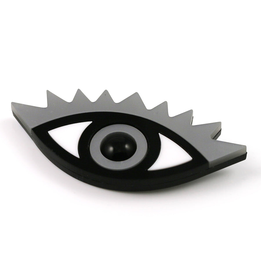 An Eye for an Eye Brooch in silver metallic