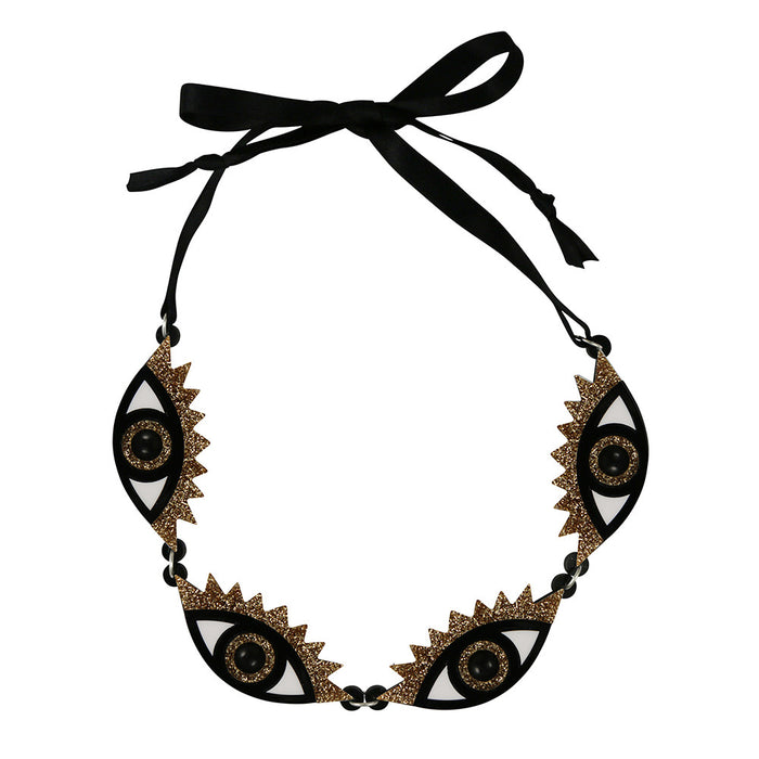 An Eye for an Eye Necklace in gold glitter