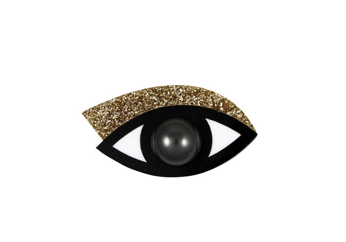 Eye brooch in gold glitter