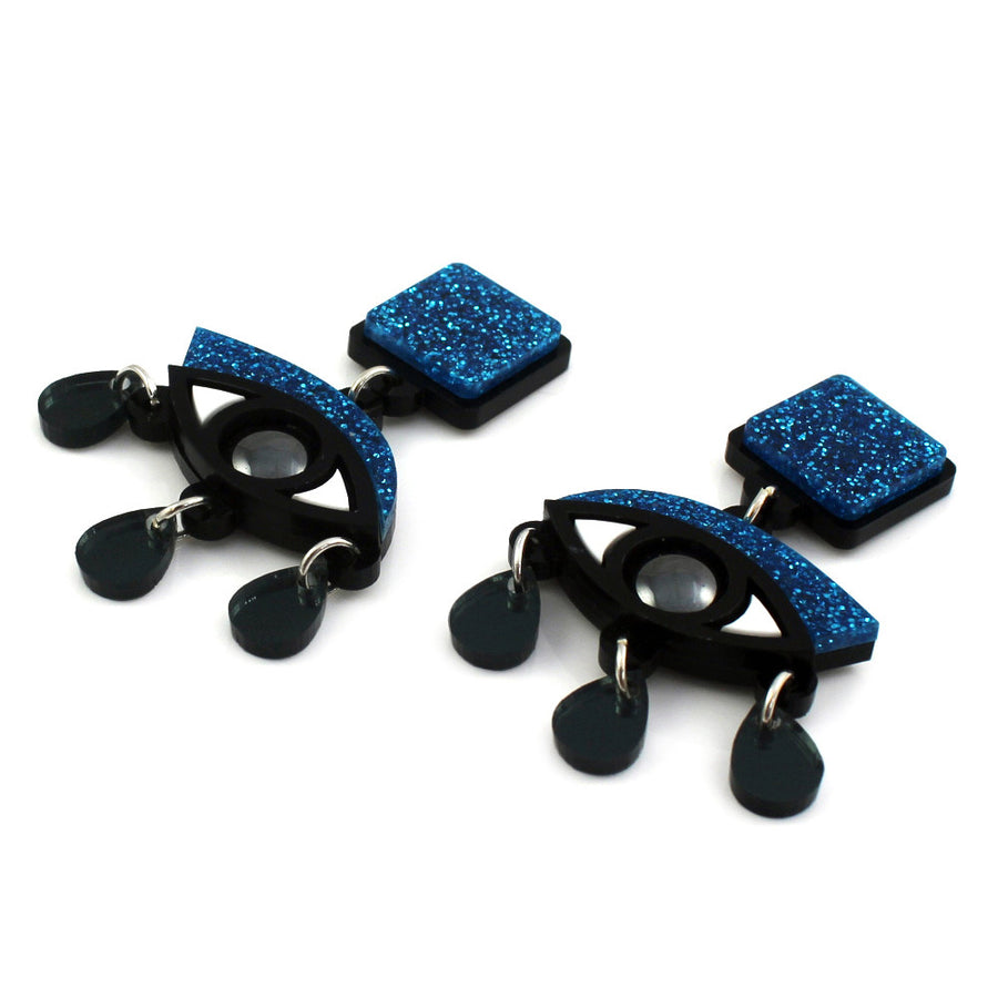 Eyes drop earrings in blue glitter perspex