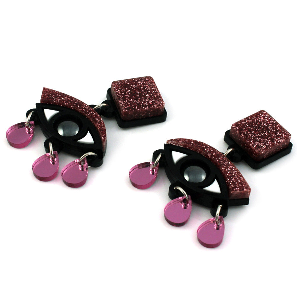 Eyes drop earrings in pink glitter perspex