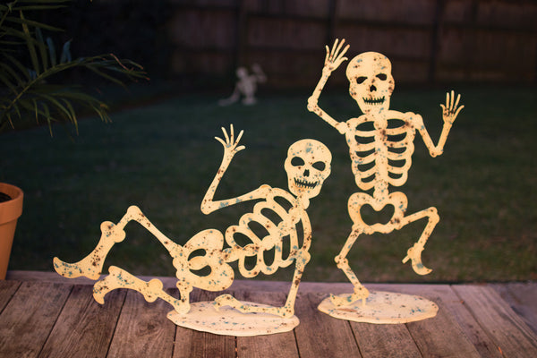 Set of 2 Glow In The Dark Skeletons On Bases
