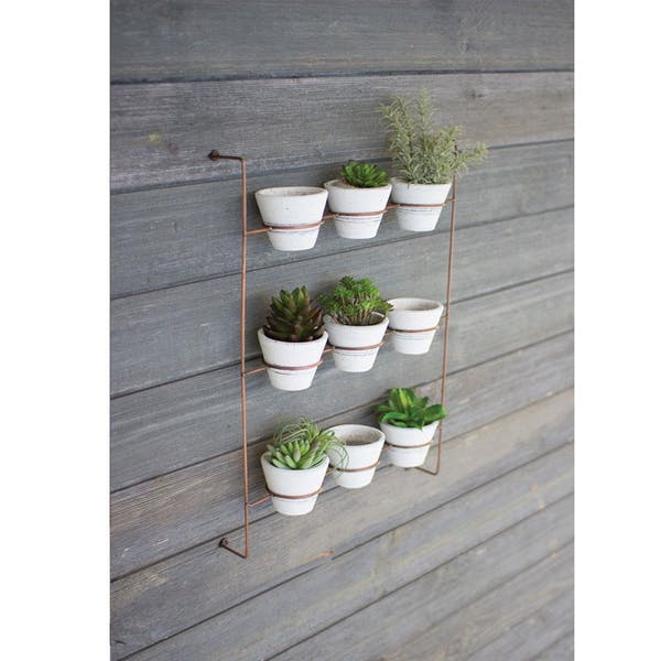 Set Of 9 White Wash Clay Pots On Copper Finish Wall Rack