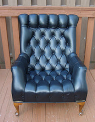 [sold] Mid-Century Tufted Black Leather Chair & Ottoman