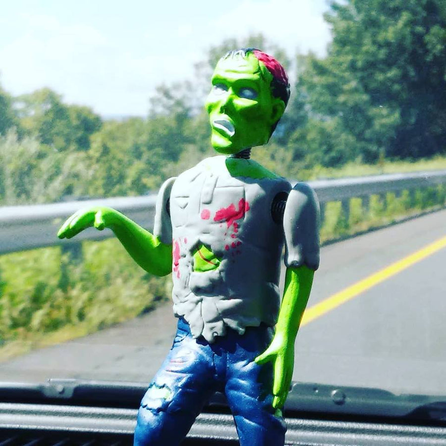 Dashboard Zombie On A Car Dashboard