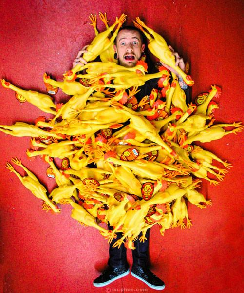 Man Covered With Deluxe Rubber Chickens
