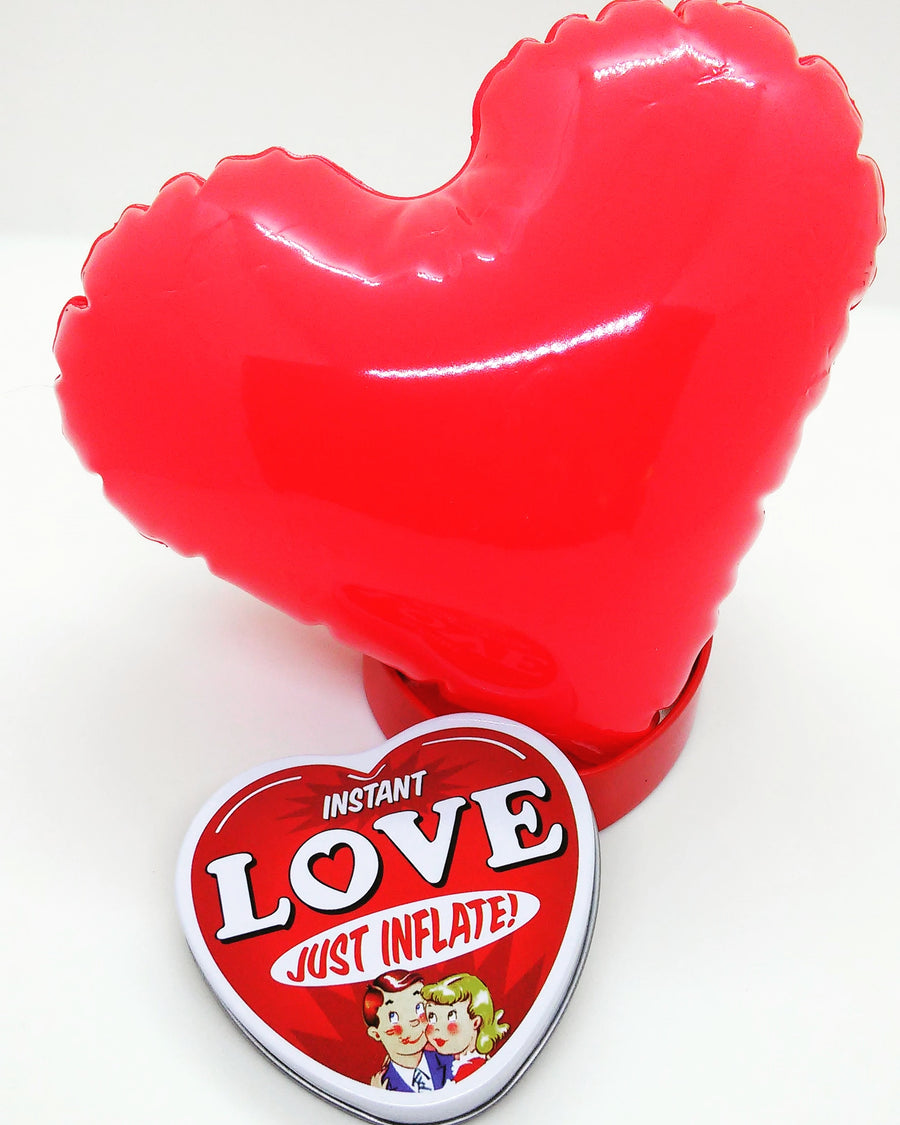 Inflatable Heart Sitting In Gift Tin