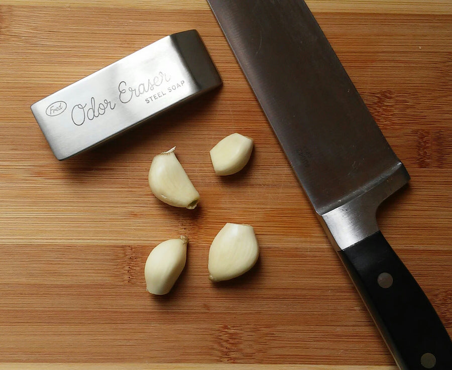 Odor Eraser On Cutting Board With Garlic And Knife