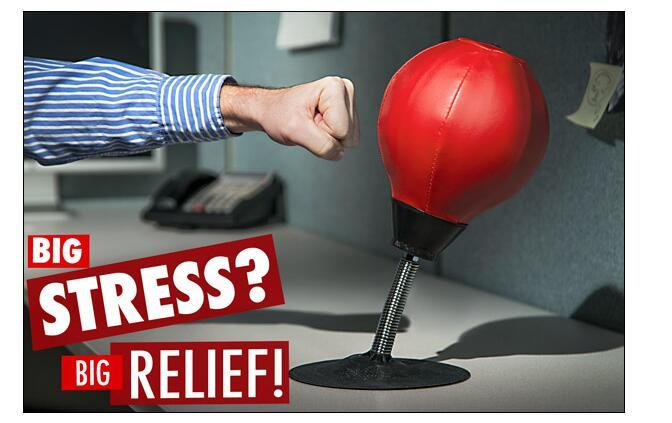 Stress Buster Punching Bag Being Punched On Desk By A Fist