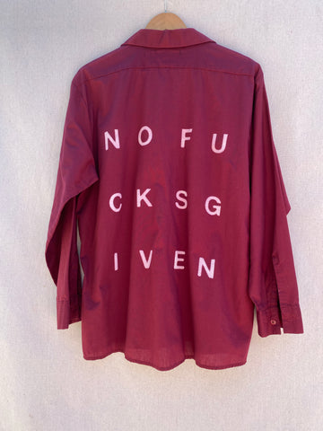 BACK VIEW OF MAROON UTILITY BUTTON DOWN SHIRT. WITH NOFUCKSGIVEN PRINT IN WHITE.