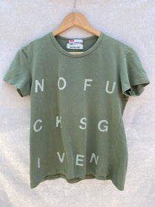 FULL FRONT VIEW OF SAGE GREEN T-SHIRT WITH NOFUCKSGIVEN PRINT ON IT.