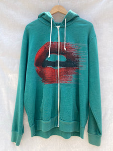 FRONT VIEW OF ZIP HOODIE WITH SIDE POCKETS IN GREEN. PRINTED WITH MOUTH WITH RED LIPS.