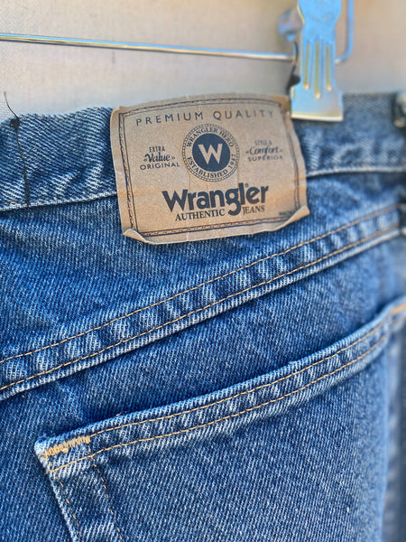 CLOSE UP VIEW OF ORIGINAL WRANGLER LABEL AT BACK WAIST.