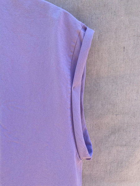 CLOSE UP VIEW OF FOLDED AND TACKED SLEEVES