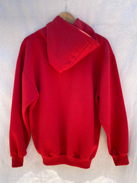 BACK VIEW OF RED LONG SLEEVE HOODIE.
