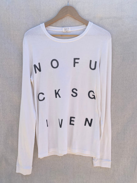 FULL FRONT VIEW OF WHITE  LONG SLEEVES TEE WITH BLACK NOFUCKSGIVEN PRINT ON IT.
