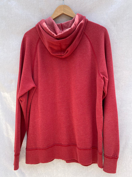 BACK VIEW OF FADED RED ZIP UP HOODIE.