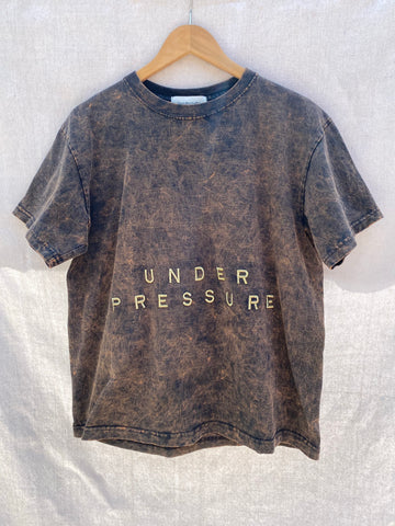 FULL FRONT VIEW OF T-SHIRT WITH UNDER PRESSURE EMBROIDERY.