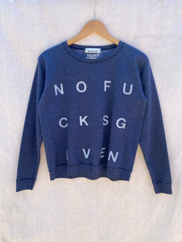 FRONT VIEW OF BLUE SWEATSHIRT WITH WHITE NOFUCKSGIVEN PRINT ON IT.