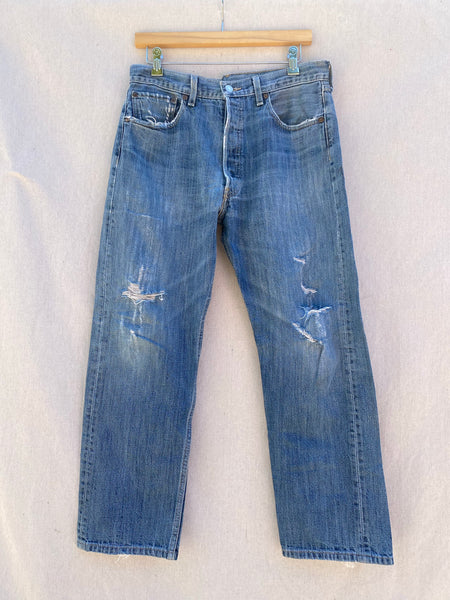 FRONT IMAGE OF DISTRESSED BLUE JEANS.