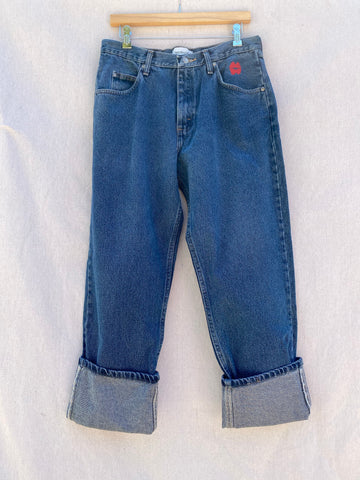 BLUE JEANS WITH RED LIPS EMBROIDERED AT LEFT POCKET AND FOLDED CUFFS.