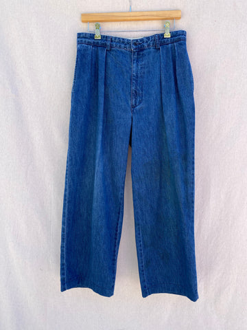 FRONT IMAGE OF DENIM PANTS WITH PLEATS.