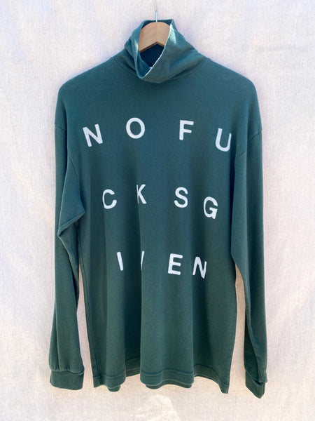 FRONT VIEW OF TURTLENECK WITH NOFUCKSGIVEN PRINT IN IVORY.
