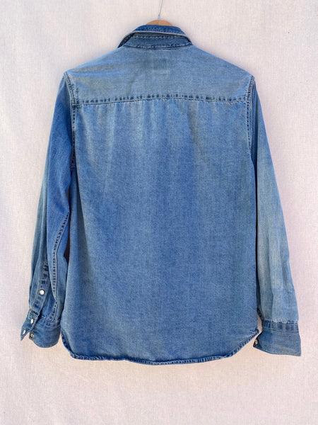 BACK IMAGE OF DENIM BUTTON DOWN SHIRT.
