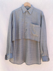 FRONT VIEW OF WINDOWPANE BUTTON DOWN LONG SLEEVE SHIRT IN GREY AND OFF WHITE.  FRONT SHIRT HEM IS SIGNIFICANTLY SHORTER THAN BACK.