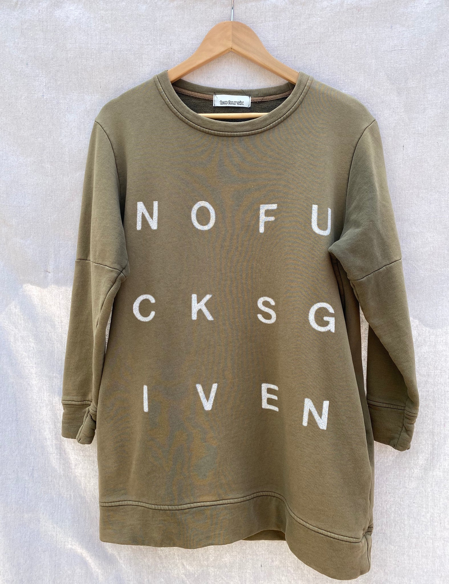 FRONT VIEW OF TUNIC LENGTH SWEATSHIRT WITH NOFUCKSGIVEN PRINT ON IT.
