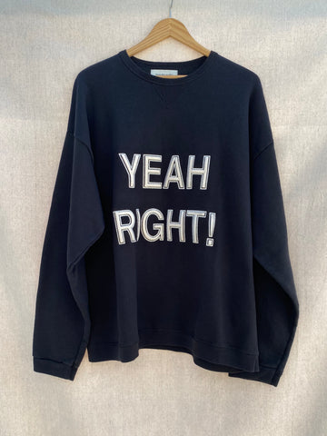 BLACK SWEATSHIRT WITH YEAH RIGHT! EMBROIDERY AT FRONT CHEST.
