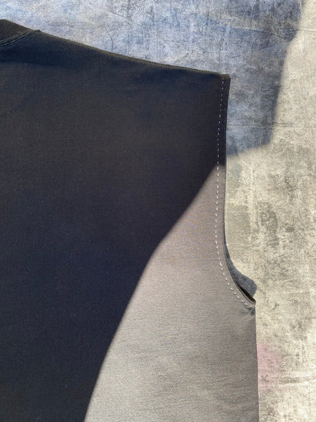 DETAILED IMAGE OF CONTRAST HAND STITCHING AT ARMHOLE.