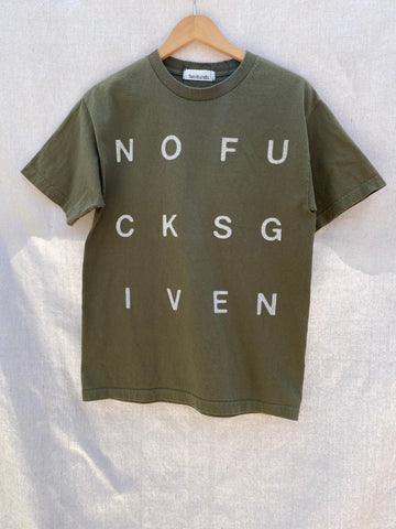 FRONT VIEW OF ARMY GREEN T-SHIRT WITH NOFUCKSGIVEN PRINTED ON IT.