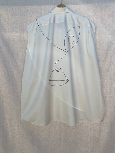 BACK IMAGE OF SLEEVELESS OVERSIZED SHIRT WITH HAND DRAWN DETAILS.