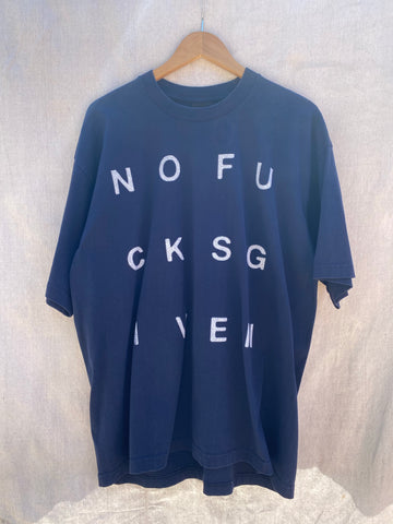 FRONT VIEW OF DARK NAVY T-SHIRT WITH WHITE NOFUCKSGIVEN PRINTED ON IT.