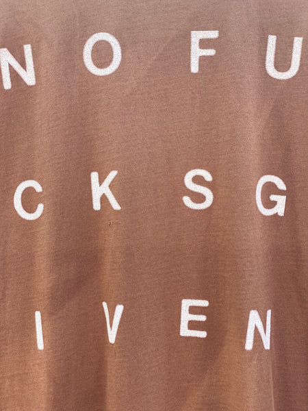 ZOOMED IN VIEW OF THE NOFUCKSGIVEN PRINT IN IVORY.
