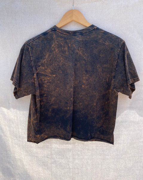 FULL VIEW OF BACK CROPPED SHIRT WITH RAW HEM AND WASHED OUT FINISH.