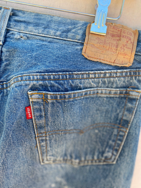 CLOSE UP VIEW OF LEVI'S LABEL AT BACK WAIST AND POCKET.