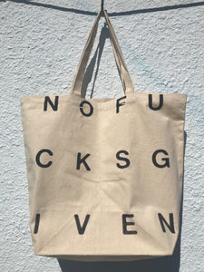 FRONT VIEW OF PRINTED TOTE BAG. PRINT READS NOFUCKSGIVEN IN BLACK.