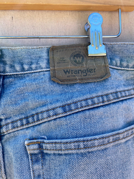 CLOSE UP VIEW OF WRANGLER LABEL AT BACK WAIST.