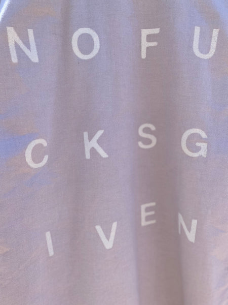 CLOSE UP VIEW OF NOFUCKSGIVEN PRINT IN WHITE BLOCK LETTERS.